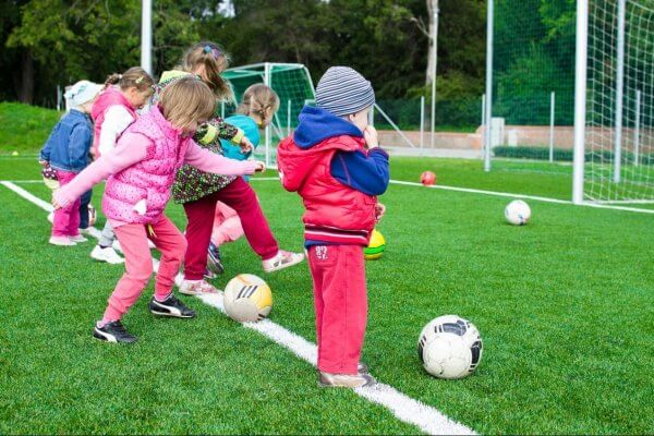 Girls and boys playing football, gender neutrality how important is it for kids' worlds?, Be Curious