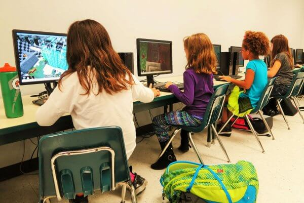 Image of children playing Minecraft in the classroom, Be Curious