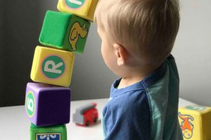 Boy playing with toy blocks, Toys are more than just toys, Be Curious