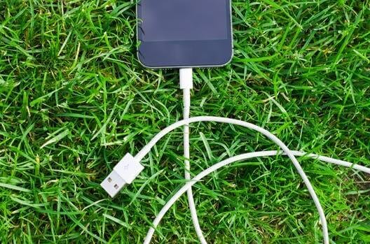 Picture of a phone switched off and unplugged. 23% of parents say that they struggle to make their children 'unplug' from their devices, Be Curious